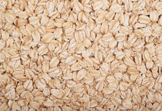 Surface coated with oatmeal flakes Stock Photos