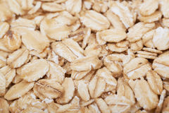Surface coated with oatmeal flakes Royalty Free Stock Photo