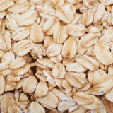 Surface coated with oatmeal flakes Royalty Free Stock Photography