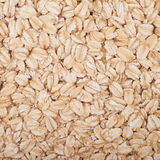 Surface coated with oatmeal flakes Stock Images