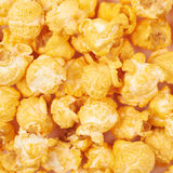 Surface coated with popcorn flakes Royalty Free Stock Photos