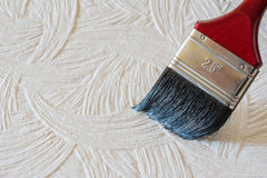The surface colors brush. Painting houses Royalty Free Stock Photography