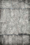 Surface of concrete wall covered with grey plates Royalty Free Stock Images