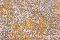 Surface of a concrete wall with traces of peeling paint Royalty Free Stock Photo