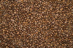 Surface covered with coffee beans as a background. Shot from above surface covered with the roasted coffee beans as a background Stock Photo