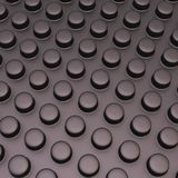 Surface covered with cylindrical bumps. Black matt plastic surface covered with multiple cylindrical bumps as an abstract background composition Royalty Free Stock Photos