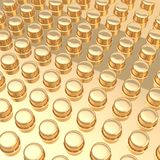 Surface covered with cylindrical bumps. Golden metal surface covered with multiple cylindrical bumps as an abstract background composition Stock Photography