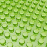 Surface covered with cylindrical bumps. Green glossy plastic surface covered with multiple cylindrical bumps as an abstract background composition Royalty Free Stock Photography