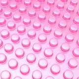 Surface covered with cylindrical bumps. Pink glossy plastic surface covered with multiple cylindrical bumps as an abstract background composition Royalty Free Stock Image