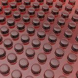 Surface covered with cylindrical bumps. Transparent red plastic surface covered with multiple cylindrical bumps as an abstract background composition Royalty Free Stock Photos