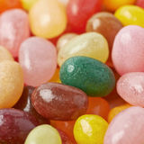 Surface covered with jelly beans. Surface covered with multiple colorful jelly bean candies as a backdrop composition Royalty Free Stock Images