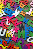 Surface covered with multiple colored wooden letters Stock Image