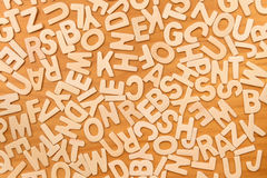Surface covered with multiple wooden letters Royalty Free Stock Images