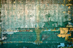 Surface is covered by old rotting peeling boards Stock Photos