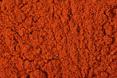 Surface covered with paprika powder Royalty Free Stock Photo