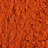 Surface covered with paprika powder Stock Photo