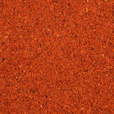 Surface covered with paprika powder. Surface covered with the red paprika powder as a background texture fragment stock image