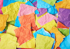 Surface covered with pieces of paper Stock Image