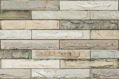 Surface Covered with Weathered and Aged Stone Tiles of Various Colors , in Horizontal Direction. Stock Images