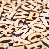 Surface covered with wooden letters Stock Photography