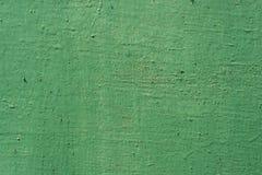 Surface criquée de fer peinte par vert de fond de texture photographie stock libre de droits