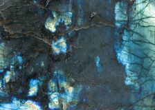 Labradorite surface showing iridescent blue color and texture royalty free stock photography