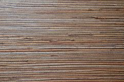 Surface of dark brown grange timber texture with horizontal dark brown and grey stripes. Wooden pattern. Horizontal wooden background stock photo