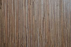Surface of dark brown grange timber texture with vertical dark brown and grey stripes. Wooden pattern. Natural material background royalty free stock photo