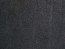 Surface of dark genuine leather background Royalty Free Stock Photo