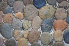 Surface de mur en pierre avec le fond de ciment image libre de droits