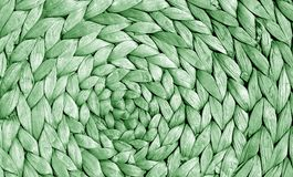 Surface de tapis de paille de couleur verte avec le modèle rond Photographie stock libre de droits