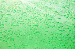 The surface of the drops of rain. The green metal surface of the drops of rain Royalty Free Stock Photos