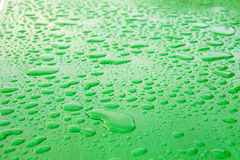 The surface of the drops of rain. The green metal surface of the drops of rain Royalty Free Stock Photography
