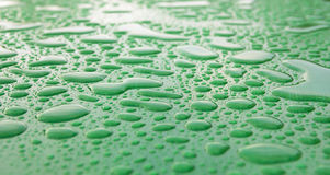 The surface of the drops of rain. The green metal surface of the drops of rain Royalty Free Stock Image