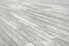 The surface with elongated rectangular stone tiles of gray color goes into diagonal perspective. The surface with elongated rectangular stone tiles of gray Royalty Free Stock Photos