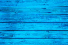 Surface of an empty blue wooden background. Royalty Free Stock Images