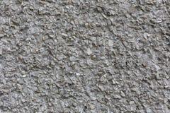 Surface en béton approximative avec le fond abstrait sans couture de texture de modèle de pierres photos stock