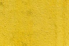 Surface en béton approximative de moutarde, papier peint abstrait inégal sans couture Wal jaune image libre de droits