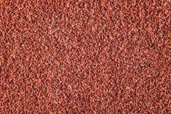 Surface en caoutchouc de couleur rouge ou texture courante de voie Photos stock