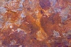 Surface en pierre rouillée avec les taches grises Images libres de droits