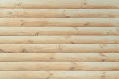 Surface is finished with a modern natural round light timber as a background Royalty Free Stock Image