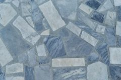The surface of the floor or wall is made of marble tiles in the form of rectangle. The surface is smooth and even. Rectangle tiles of different size and color Stock Photos