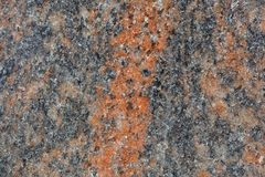Surface of a gneiss rock. Macro photo of the surface of a gneiss rock containing with red minerals Stock Images