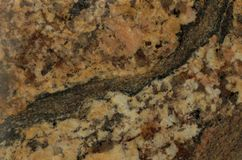 Surface of the granite. Reddish-brown shades. Royalty Free Stock Photos