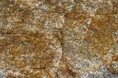 Surface of granite. Stone texture. Colored rough granite stone texture. Surface of granite. Stone texture. Rough granite stone texture stock photo