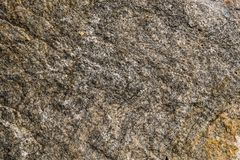 Surface of granite. Stone texture. Colored rough granite stone texture. Surface of granite. Stone texture. Rough granite stone texture stock photography