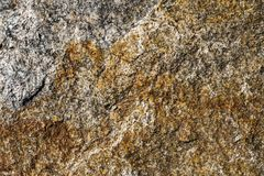 Surface of granite. Stone texture. Colored rough granite stone texture. Surface of granite. Stone texture. Rough granite stone texture royalty free stock image