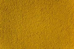 Surface granulaire jaune lumineuse avec des ombres Texture approximative photographie stock libre de droits