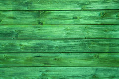 Surface of a green wooden background. Royalty Free Stock Images