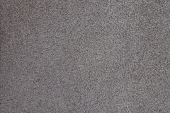 Surface of grey exterior wall with pebbledash. Surface of gray exterior wall with pebbledash royalty free stock photography